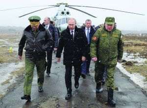 Russian President Vladimir Putin watches military exercises in Leningrad Region