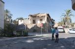 Nicosia nord, due ragazzi turchi passeggiano davanti a una casa distrutta dal conflitto del 1973 | © Michele Cirillo